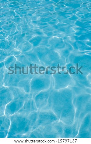 Ripples in swimming pool water surface, sunlight reflections - stock photo