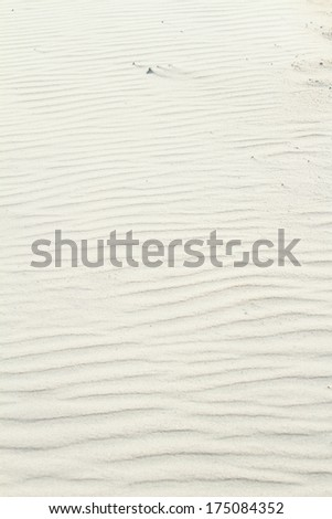 Ripples in the sand on a beach - stock photo