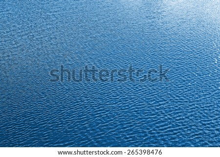 ripples on  surface of blue water - stock photo