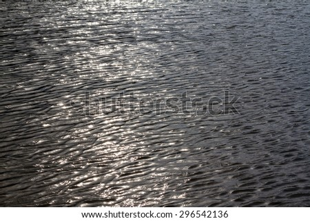 Rippling blue water surface, water river for background, silver background - stock photo
