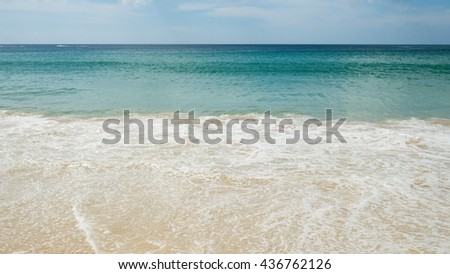 Rippling water surface of sea. Sea waves with white foam background wallpaper. Surface of wave in the blue tone color from ocean. - stock photo