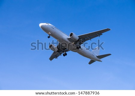rising airplane in blue sky - stock photo