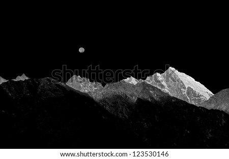 Rising full moon over the mountains near Lukla - Nepal (black and white) - stock photo