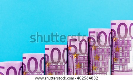 rising steps made of 500 euro banknotes on blue background - stock photo
