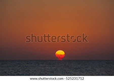 Rising sun goes up from sea, Marsa Alam, Egypt