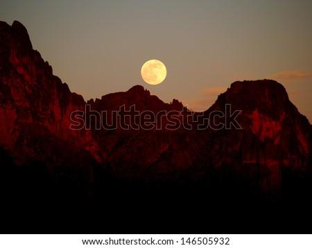 Rising Supermoon at Sunset - stock photo