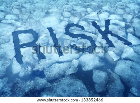 Risk and danger as a thin ice concept with the word embedded in a cracked frozen lake warning any person to be very cautious as a business symbol of hazardous situation that is very dangerous. - stock photo