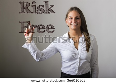 Risk Free - Beautiful girl touching text on transparent surface - horizontal image