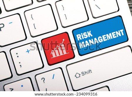 risk management concept on keyboard - stock photo
