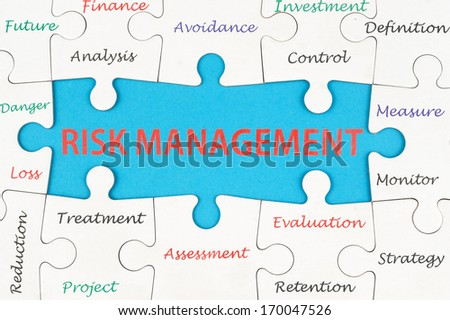 Risk management concept words on group of jigsaw puzzle pieces - stock photo