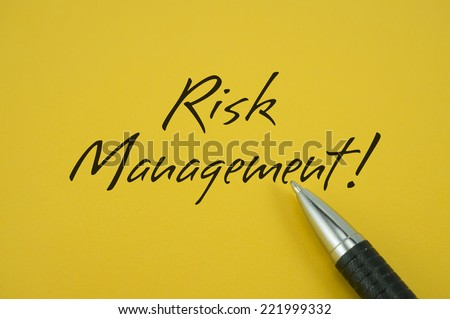 Risk Management! note with pen on yellow background
