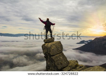 risky climbing success - stock photo