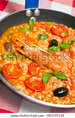Risotto con Gamberi alla Napoli, or Rice with Prawns Neapolitan style in skillet pan for one person. See more Italian food - stock photo
