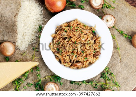 Risotto mushrooms with parmesan cheese, fresh herbs, rice, onion.