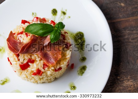 Risotto overhead on a wooden table - stock photo