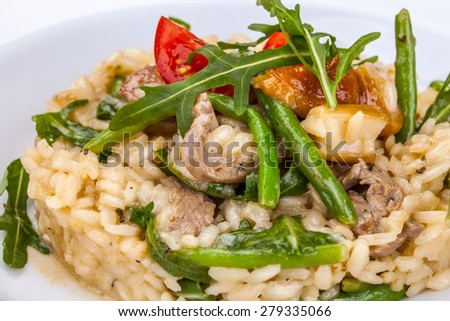 Risotto with meat and vegetables - stock photo