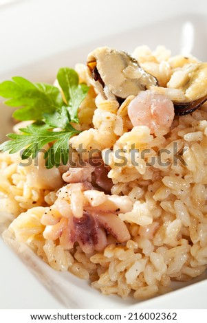 Risotto with Mussels, Octopus and Parsley - stock photo