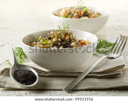 risotto with poppy seed and carrots,healthy food - stock photo