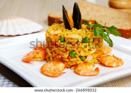 Risotto with shellfish, paella - stock photo