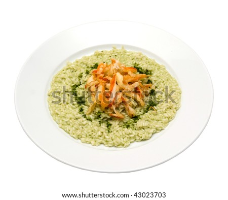 risotto with spinach and crab meat - stock photo