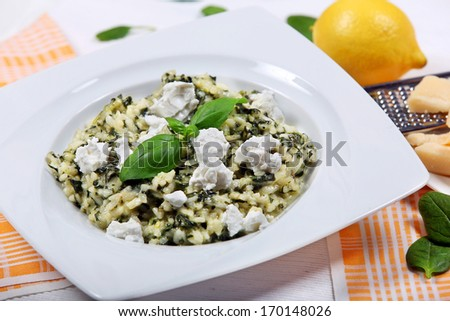 Risotto with spinach and goat cheese - stock photo