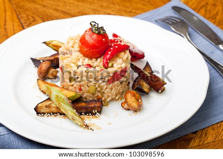 risotto with vegetable on wooden table