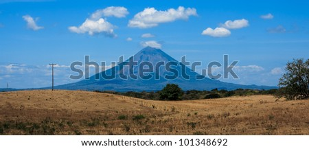 RIVAS, NICARAGUA: Panoramic view of Conception Volcano and dry fields on Isla de Ometepe - stock photo
