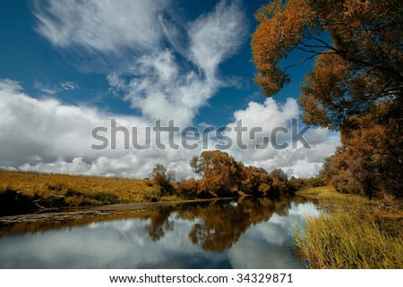 River and blue sky in autumn