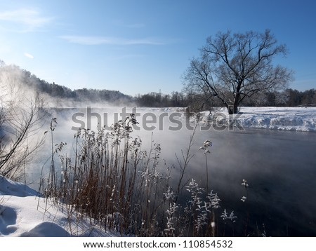 River and frozen trees at winter morning in Russia - stock photo