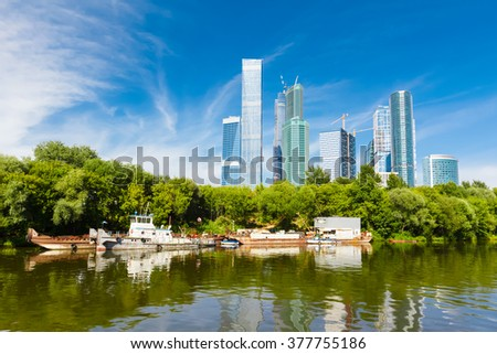 river and green trees on background modern built the skyscrapers in the Moscow city - stock photo