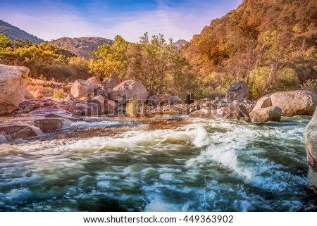 River and mountain in nature: Autumn creek woods with yellow trees foliage and rocks in forest mountain with HDR effects for travel nature river river nature mountain background  river nature - stock photo