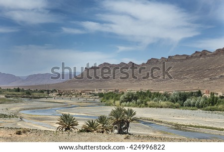 River and old berber village inAtlas mountains, Morocco - stock photo