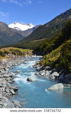 River and Snowy Mountain Peak - stock photo
