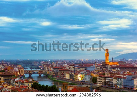 River Arno with bridge Ponte Vecchio and Palazzo Vecchio at night from Piazzale Michelangelo in Florence, Tuscany, Italy - stock photo