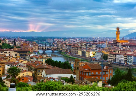 River Arno with bridge Ponte Vecchio and Palazzo Vecchio at sunset from Piazzale Michelangelo in Florence, Tuscany, Italy - stock photo