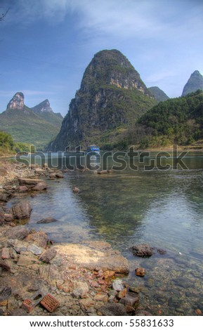 river boat at the li river yangshuo china - stock photo