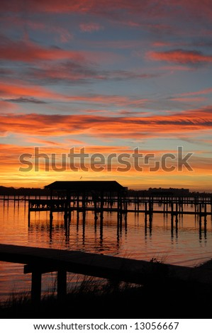 river boathouse in the sunrise - stock photo