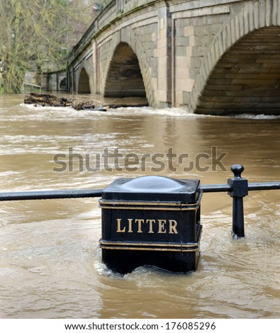 river bursting banks on rain storm - stock photo