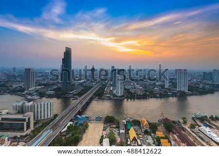 River cross Bangkok city downtown with beautiful sunset sky background