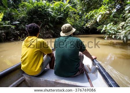 River cruising in tropical jungle of Kenong, Pahang.  - stock photo
