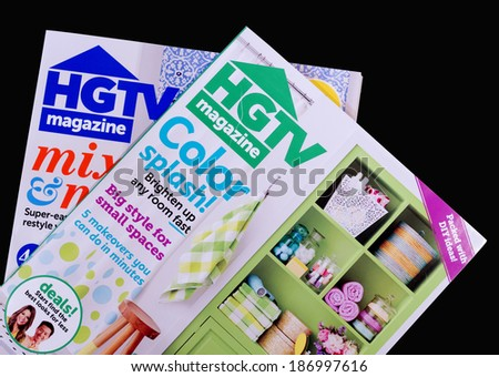 RIVER FALLS, WISCONSIN - APRIL 12, 2014: Two issues of HGTV Magazine. HGTV Magazine is published monthly by Hearst Communications Inc. - stock photo