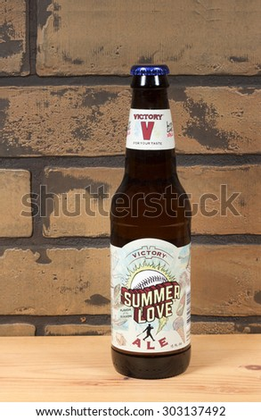 RIVER FALLS,WISCONSIN-AUGUST 04,2015: A bottle of Summer Love ale. This beverage is made by Victory Brewing Company of Downington,Pennsylvania. - stock photo