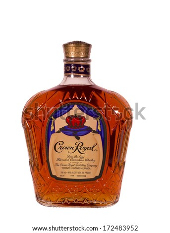 RIVER FALLS,WISCONSIN-JANUARY 21,2014: A bottle of Crown Royal whisky. Crown Royal is a blended Canadian whisky 40% alcohol by volume,80 proof. - stock photo