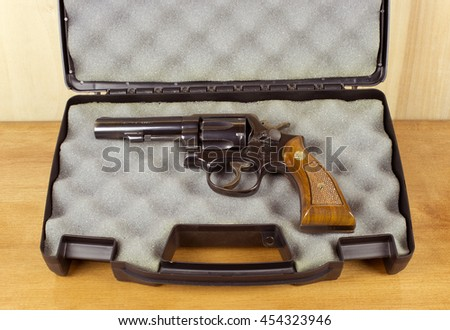 RIVER FALLS,WISCONSIN-JULY 18,2016: A vintage Smith and Wesson thirty eight caliber revolver in a padded case. - stock photo