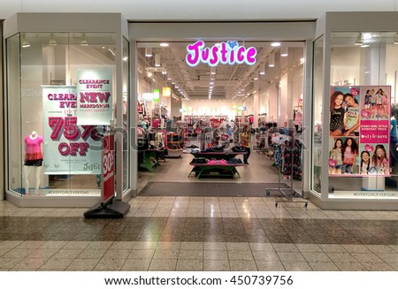 RIVER FALLS,WISCONSIN-JULY 10,2016: The Justice clothing sign and storefront. Justice is operated by Tween Brands Incorporated. - stock photo