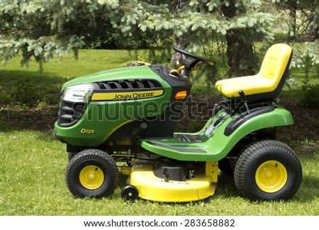 RIVER FALLS,WISCONSIN-JUNE 02,2015: A John Deere lawn tractor in River Falls,Wisconsin on June 02,2015. Deere and Company is Headquartered in Moline,Illinois. - stock photo
