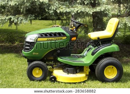 RIVER FALLS,WISCONSIN-JUNE 02,2015: A John Deere lawn tractor in River Falls,Wisconsin on June 02,2015. Deere and Company is Headquartered in Moline,Illinois. - stock photo