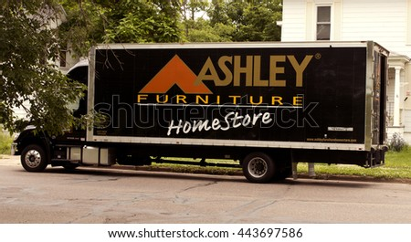 RIVER FALLS,WISCONSIN-JUNE 26,2016: An Ashley Furniture truck delivering new items to a urban residence. - stock photo