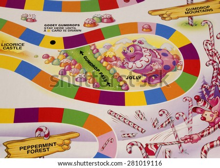 RIVER FALLS,WISCONSIN-MAY24,2015: A section of the Candy Land game board featuring Jolly the Clown. Candy Land was first published in Nineteen Forty Nine. - stock photo