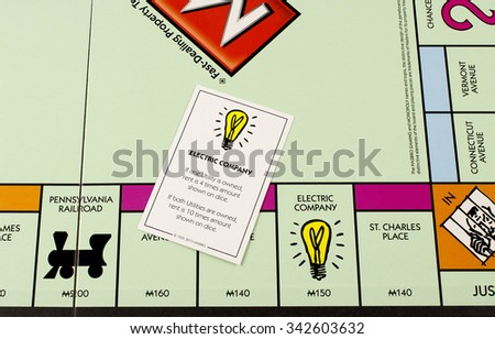 RIVER FALLS,WISCONSIN-NOVEMBER 21,2015: A closeup view of a Monopoly board featuring the Electric Company card. - stock photo
